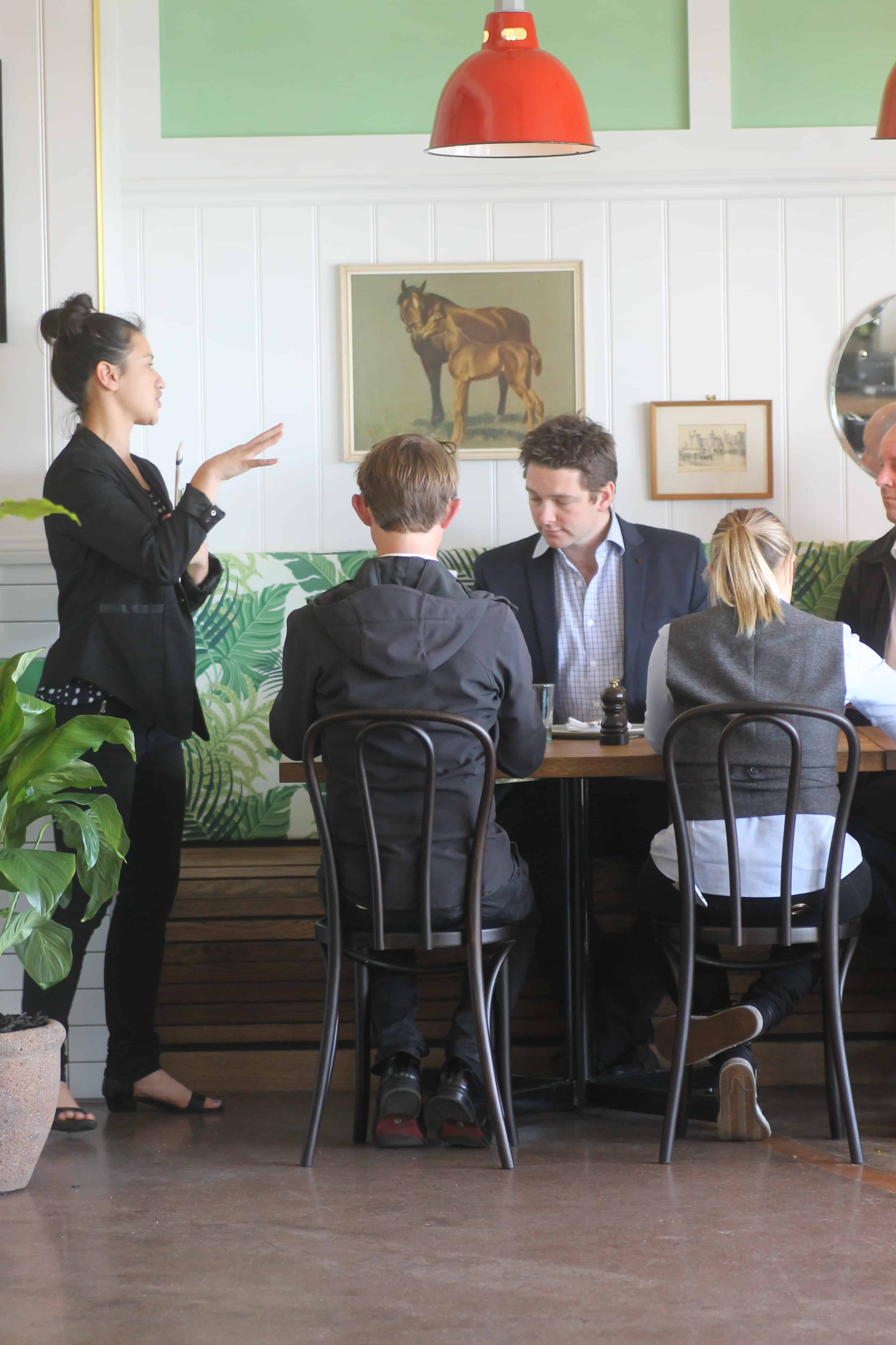 Culpepper restaurant in Auckland table and chair design with staff serving customers