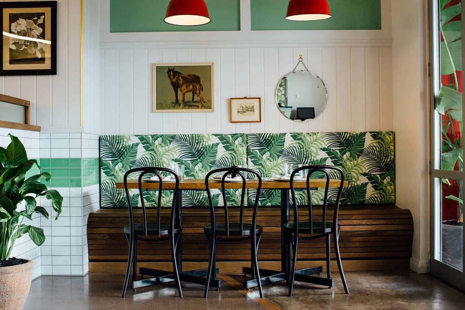 Culpepper restaurant in Auckland table and chair design including bench seating and leafy back wall