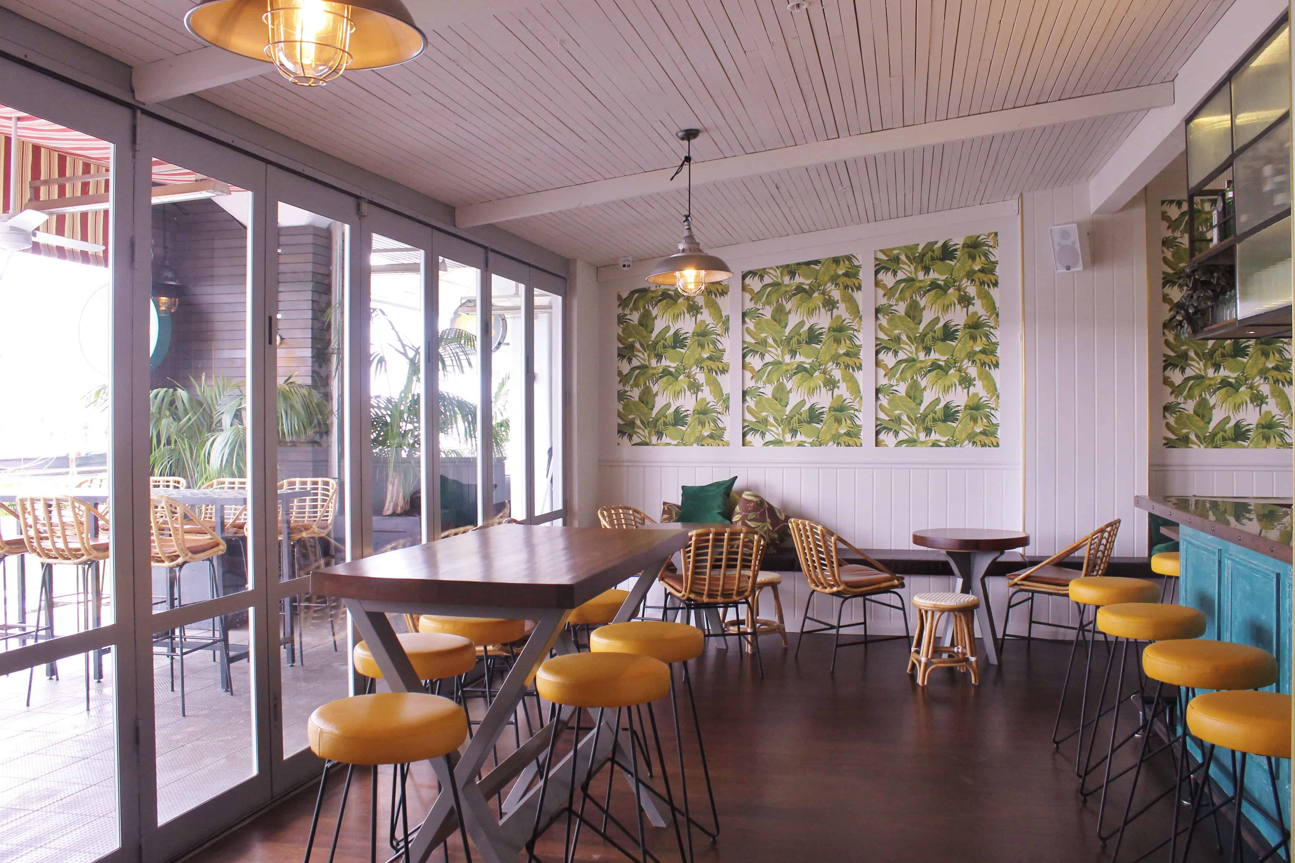 Culpepper restaurant in Auckland table and chair design with featured yellow chairs