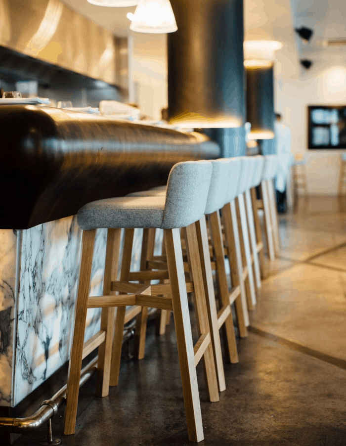 Euro restaurant in Auckland bar design including white bar chairs