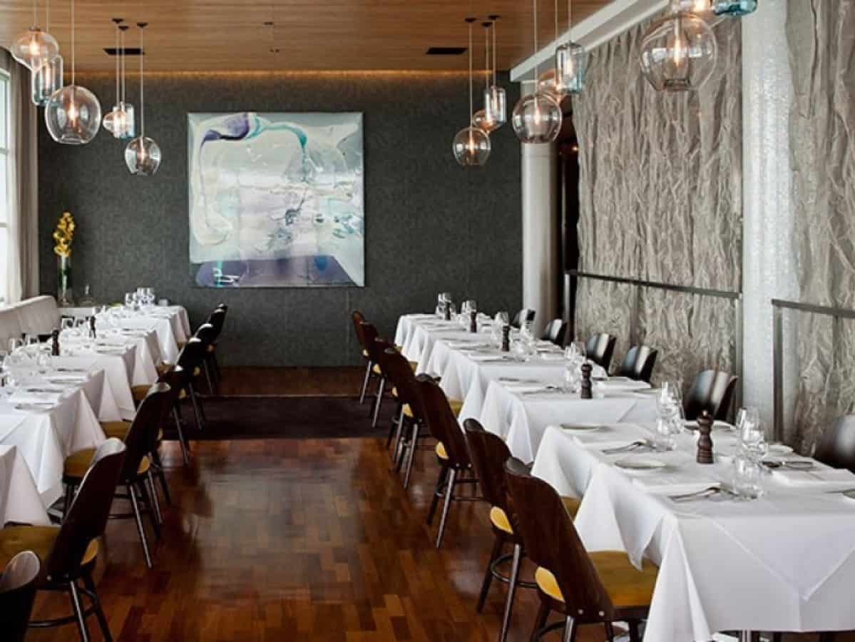 Fish restaurant in Auckland dining room design with featured wall and art in the background