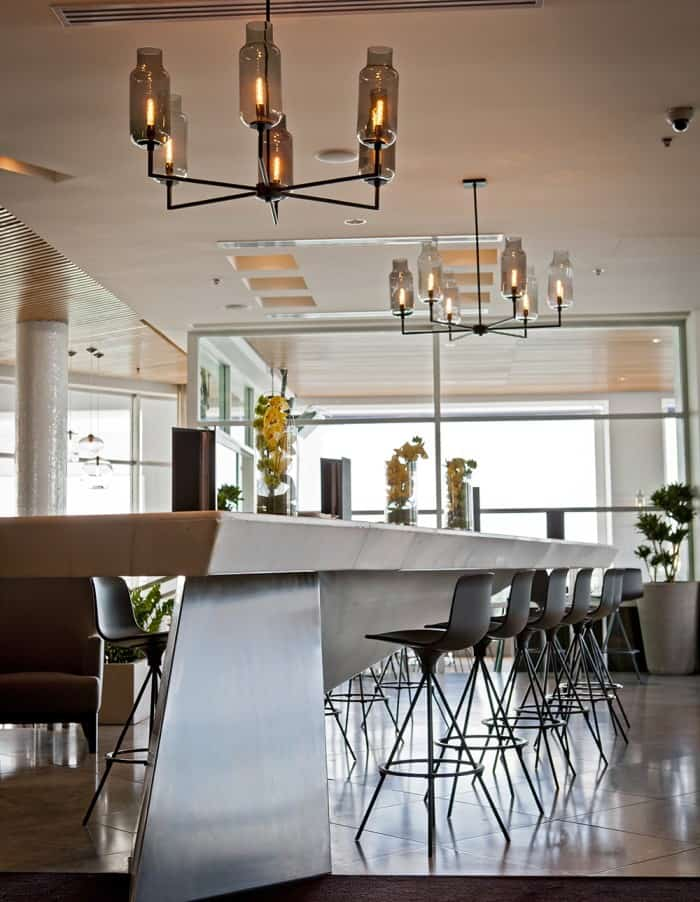 Fish restaurant in Auckland waiting area with concrete high table and stools and glass light fittings