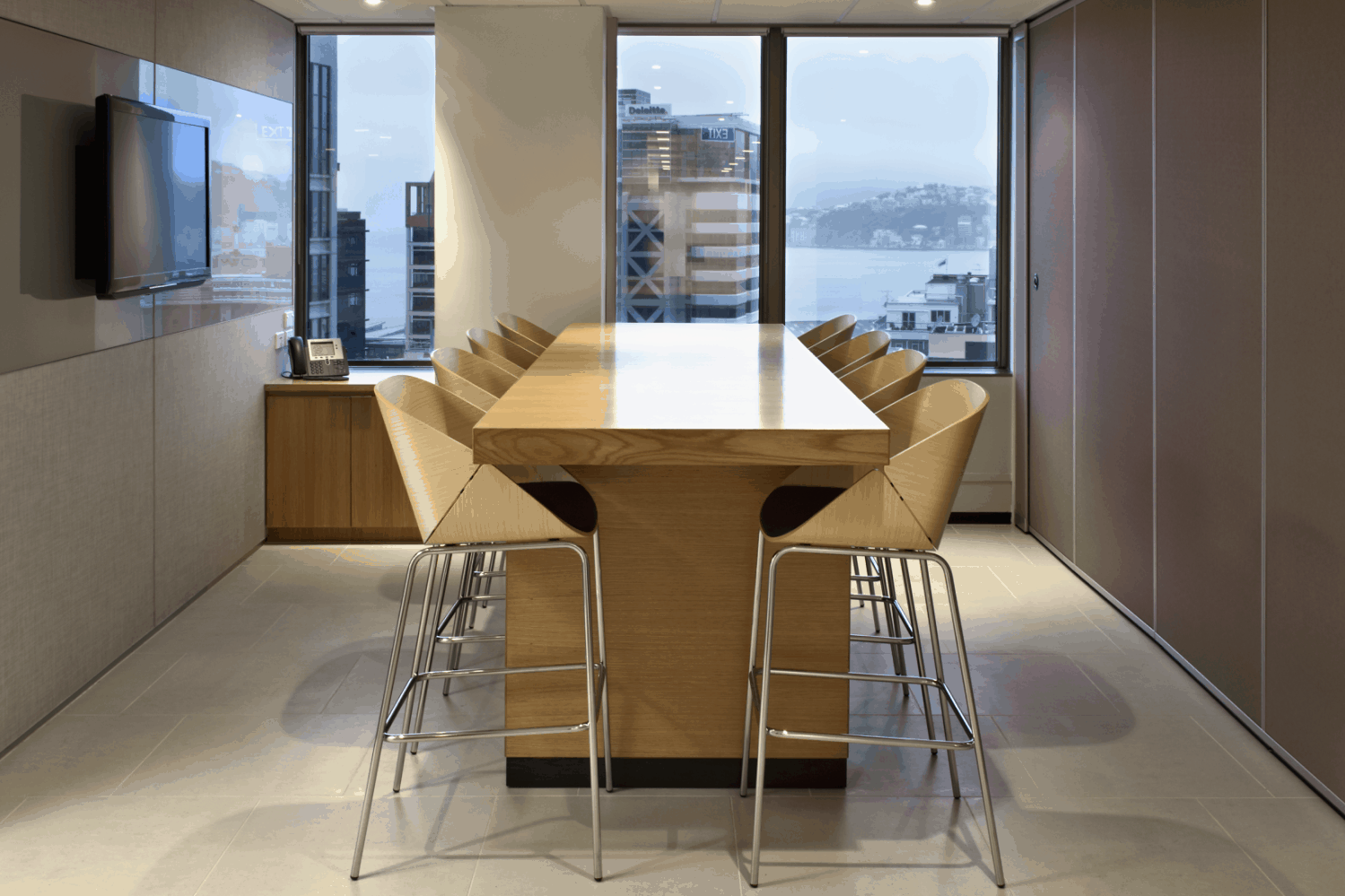 BNP Paribas in Wellington office workplace meeting room design including high table and chairs and TV