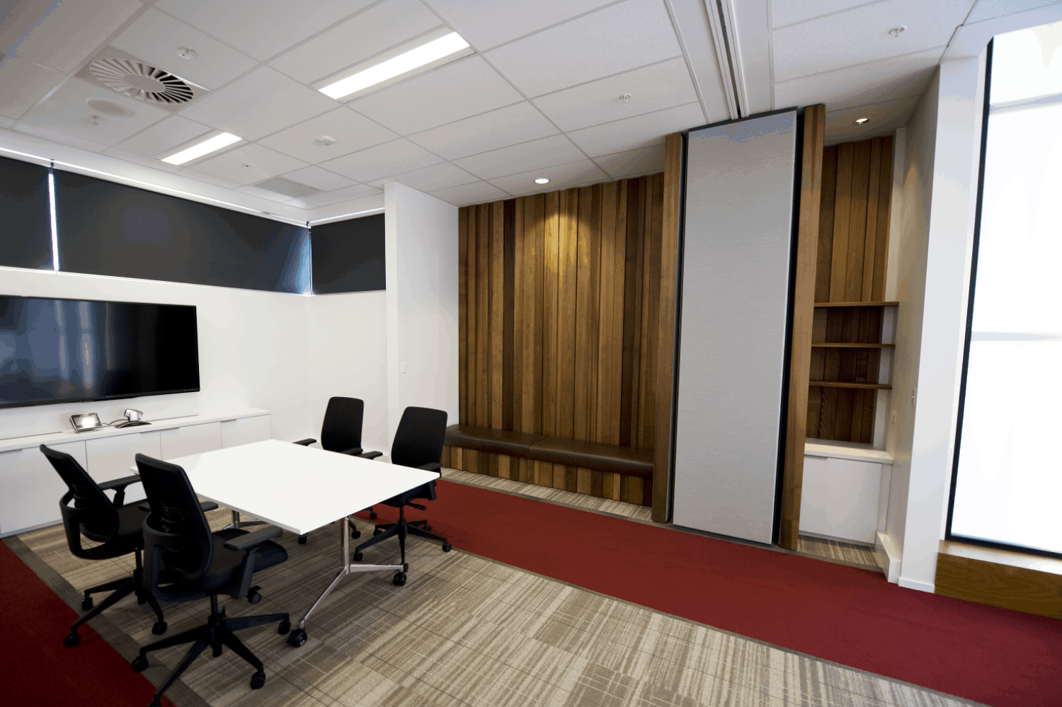 Jones Lang Lasalle in Christchurch office workplace meeting room design with table, chairs and TV