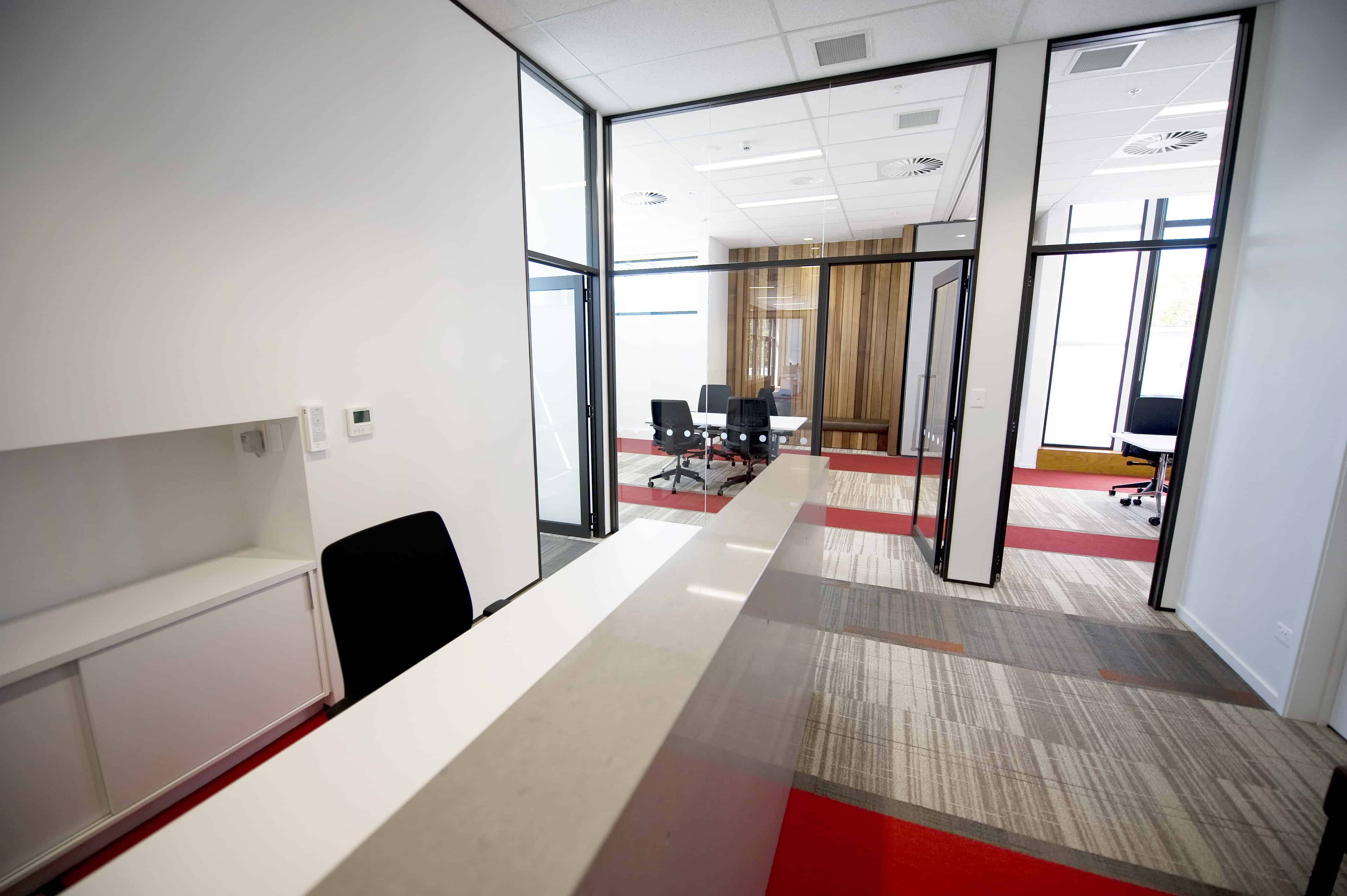Jones Lang Lasalle in Christchurch office workplace reception design with view of meeting rooms in the background