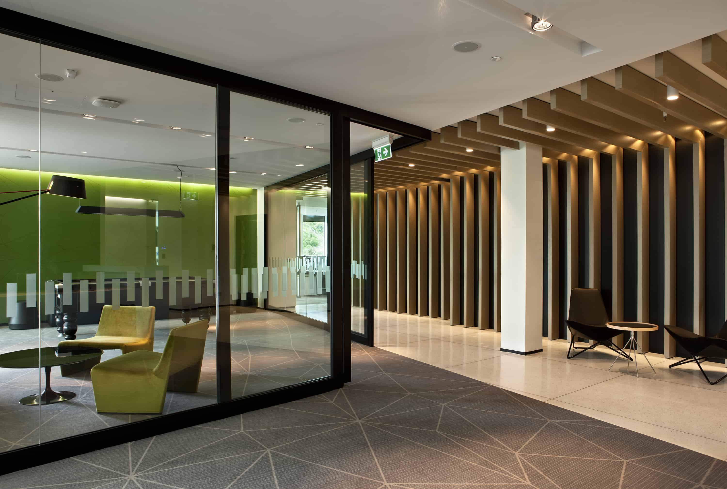 Citrix office workplace in Auckland entrance design with bright green feature wall