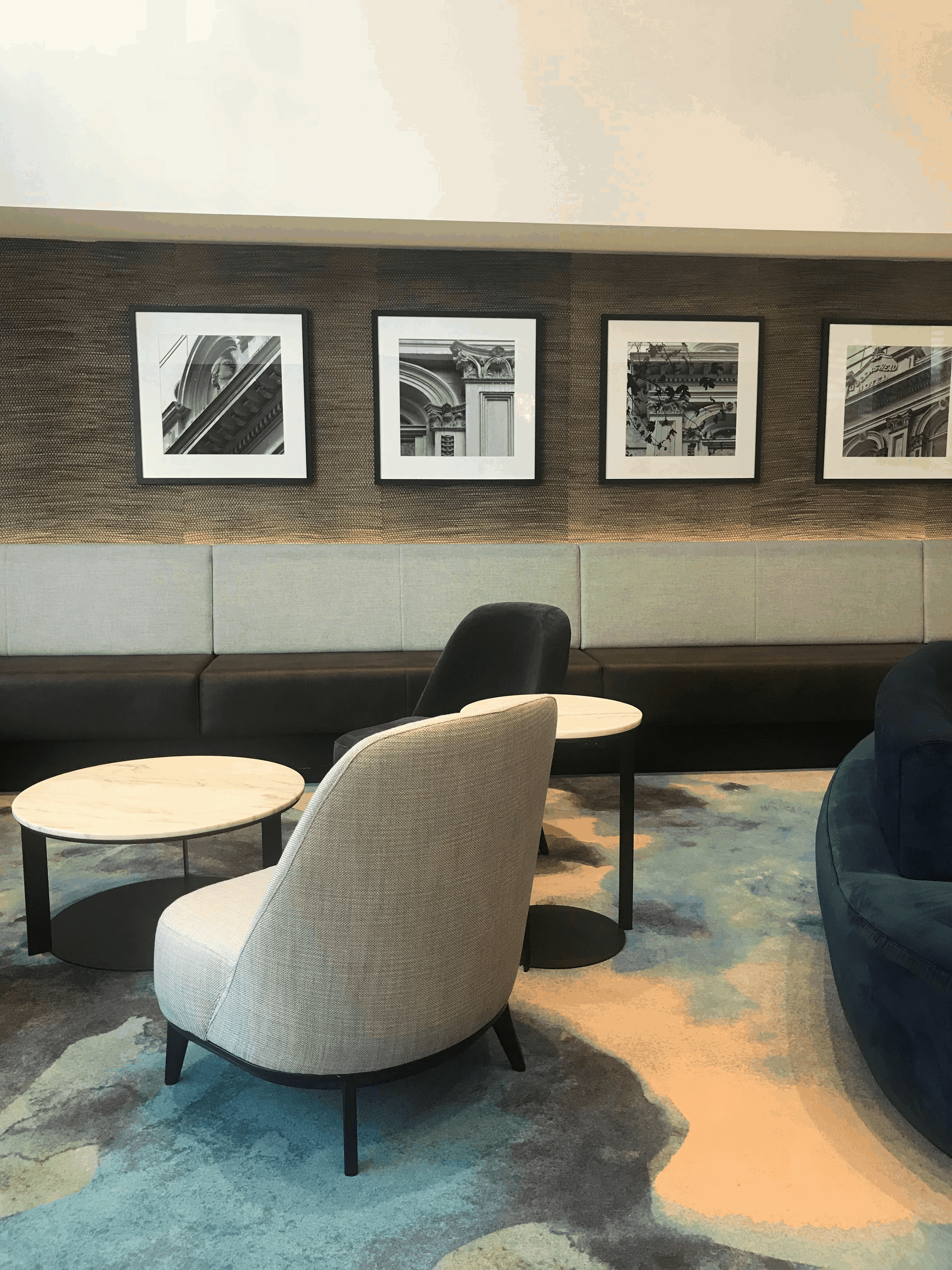 Sheraton Four Points hotel in Auckland foyer seating design with black and white photographs on the walls