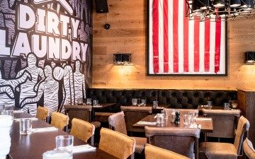 Dirty Laundry restaurant and bar in Auckland dining room design with American flag hanging on wall