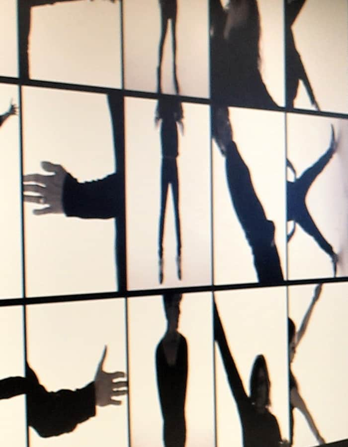 IBM office in Auckland workplace feature art wall design with silhouettes of people in various positions to spell THINK