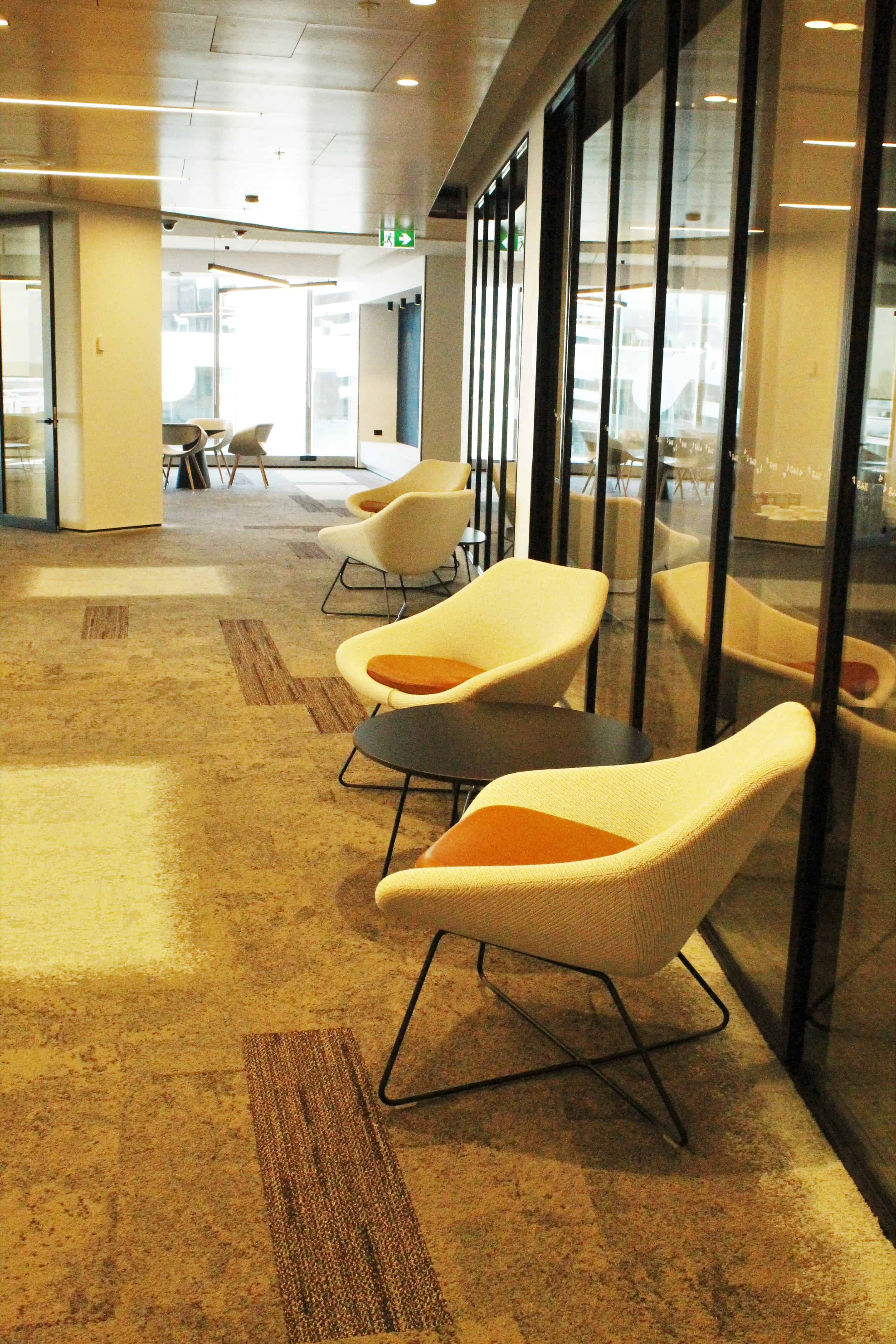 IBM office in Auckland workplace hallways design with tables and chairs and glass walls