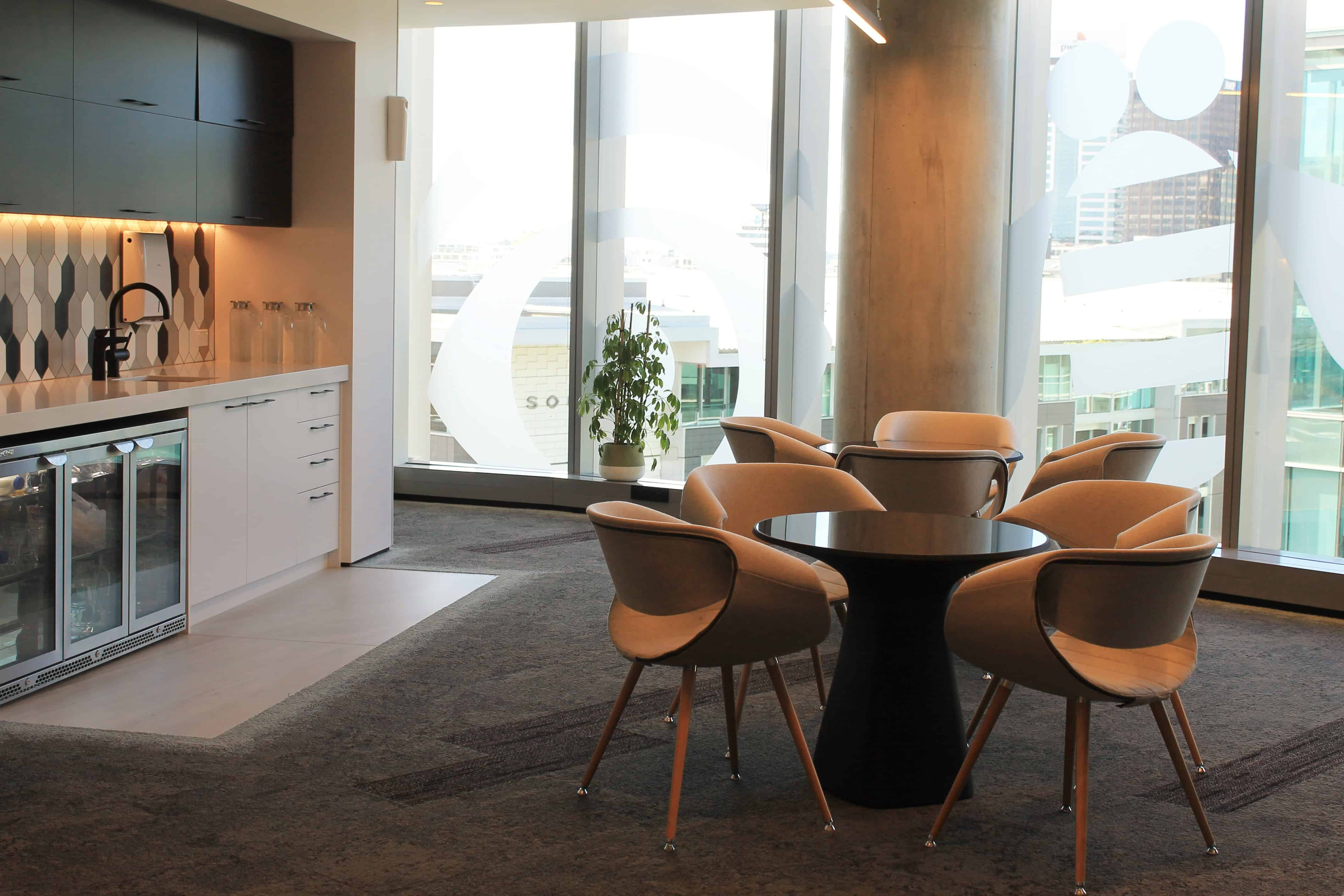 IBM office in Auckland workplace kitchen design with sink, fridges, tables and chairs