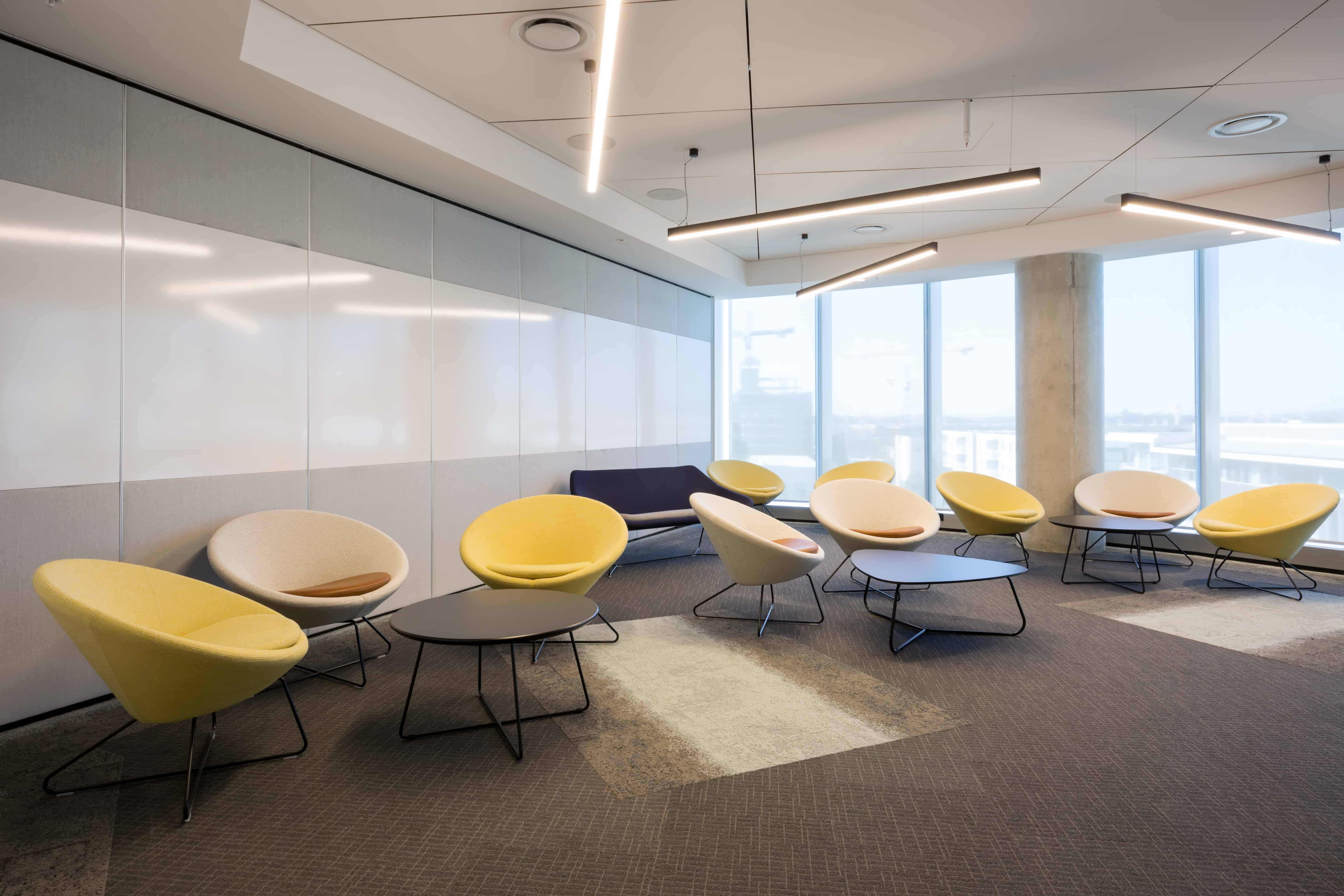 IBM office in Auckland workplace open meeting space with low tables and chairs