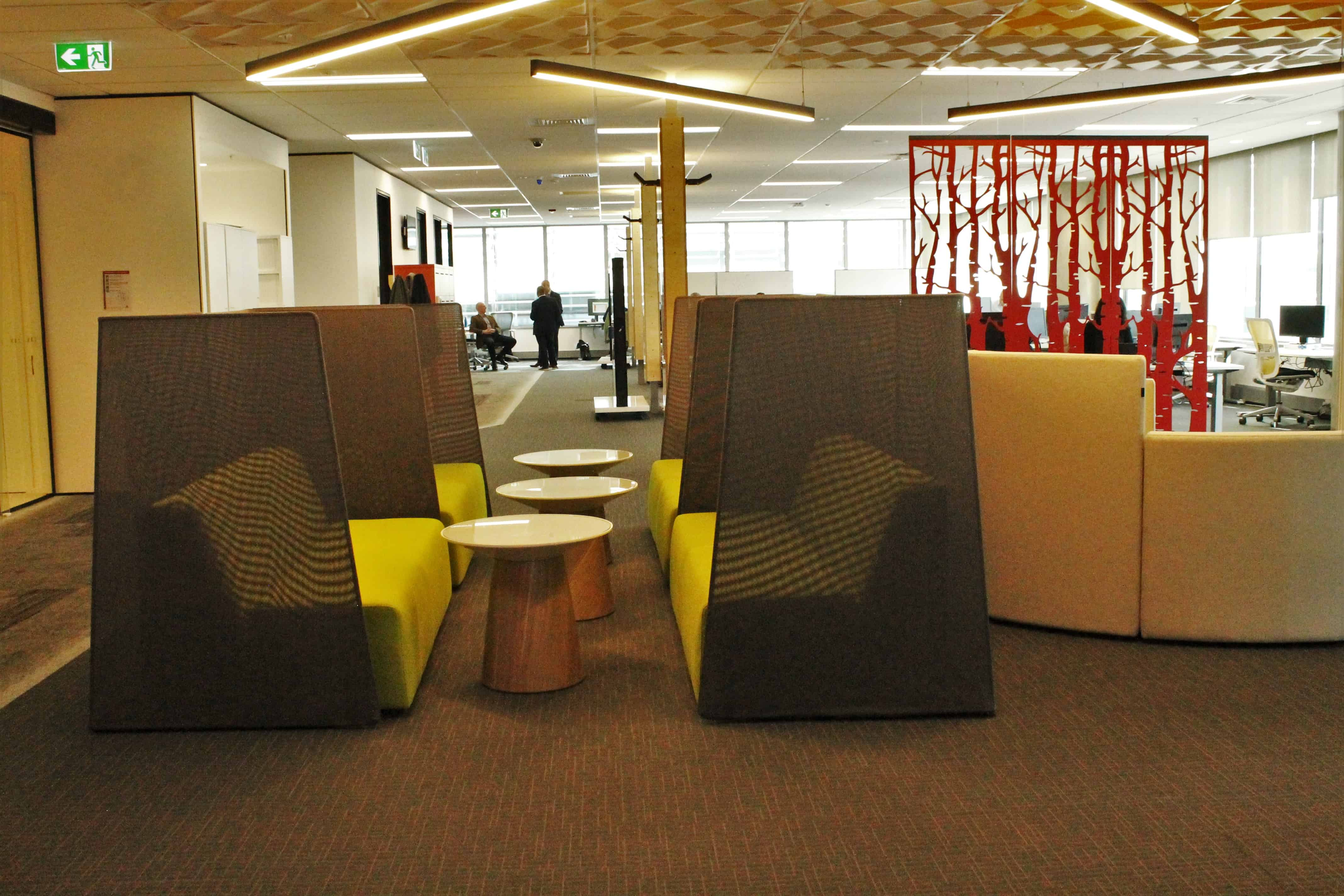 IBM office in Auckland workplace open meeting space with tables and chairs