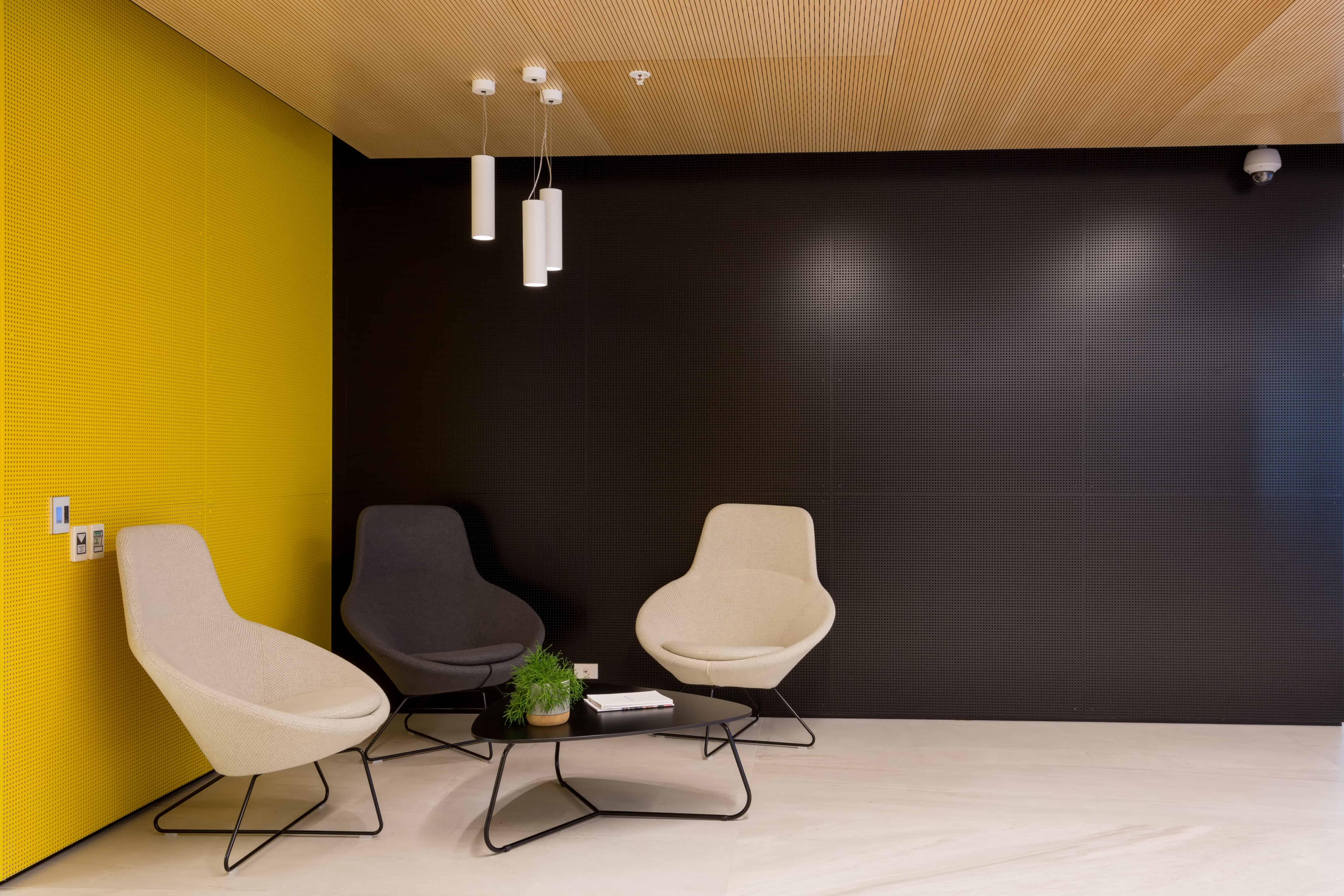 IBM office in Auckland workplace waiting area design with yellow and blue walls and low table and chairs